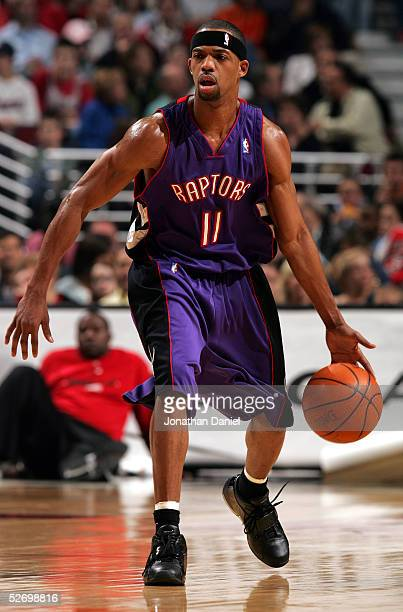 Rafer Alston of the Toronto Raptors drives against the Chicago Bulls during the game at the United Center on April 9 2005 in Chicago Illinois The...