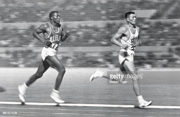 Rafer Johnson of the United States competes against Yang Chuan-kwang of China in the 1500 Metres portion of the Decathlon competition during the 1960...