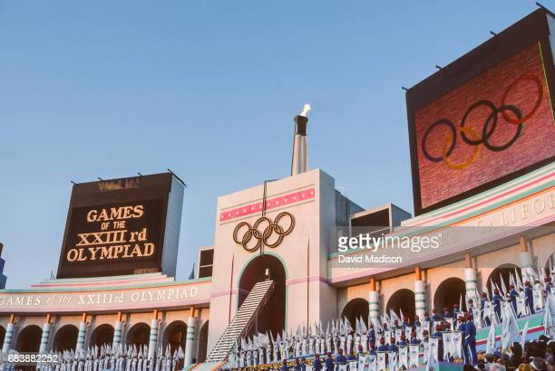 Rafer Johnson of the USA lights the Olympic Flame during the Opening Ceremony of the 1984 Summer Olympics at the Los Angeles Memorial Coliseum on...