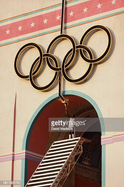 Rafer Johnson of the USA raises the Olympic Torch to light the Olympic Flame during the Opening Ceremony of the 1984 Summer Olympics at the Los...