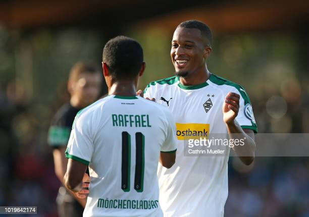 Raffael and Alassane Plea of Borussia Moenchengladbach celebrate after scoring during the DFB Cup first round match between BSC Hastedt and Borussia...