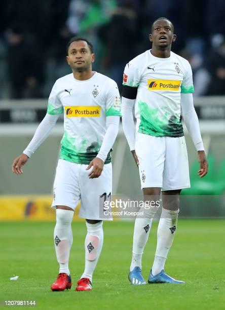 Raffael and Denis Zakaria of Borussia Monchengladbach look dejected after conceding a goal during the Bundesliga match between Borussia...