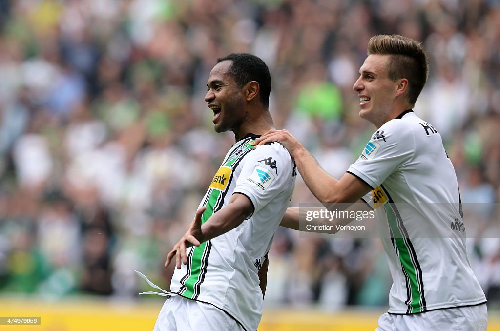 Raffael and Patrick Herrmann of Borussia Moenchengladbach celebrate after the first goal during the Bundesliga match between Borussia Moenchengladbach and FC Augsburg at Borussia Park Stadium on May 23, 2015 in Moenchengladbach, Germany.