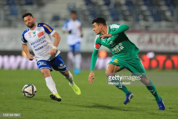 Raffael Behounek of Tirol and Dario Tadic of Hartberg during the Tipico Bundesliga match between TSV Prolactal Hartberg and WSG Swarovski Tirol at...