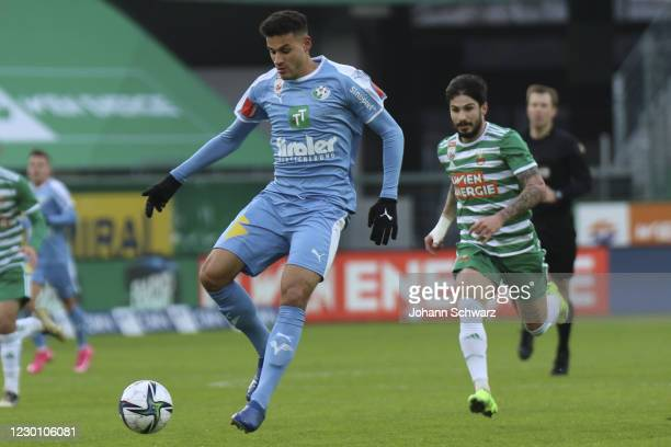 Raffael Behounek of WSG Tirol and Taxi Fountas of Rapid during the tipico Bundesliga match between SK Rapid Wien and WSG Swarovski Tirol at Allianz...