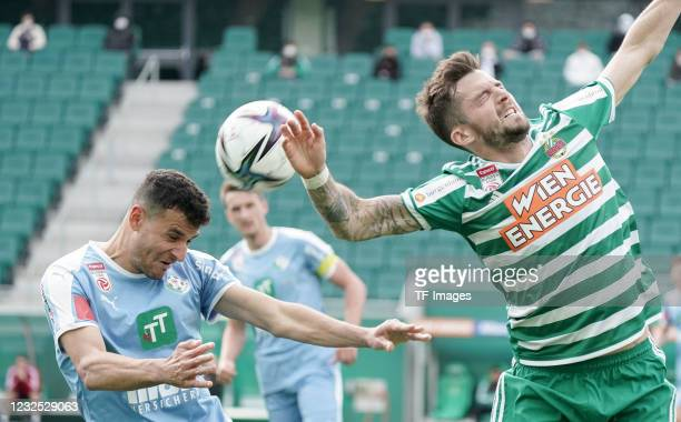 Raffael Behounek of WSG Tirol, Christoph Knasmuellner of SK Rapid Wien battle for the ball during the tipico Bundesliga match between SK Rapid Wien...