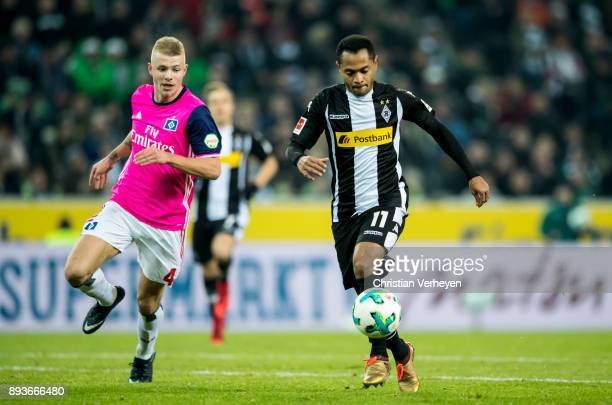 Raffael is chased by Rick van Drongelen of Hamburger Sv during the Bundesliga match between Borussia Moenchengladbach and Hamburger SV at...