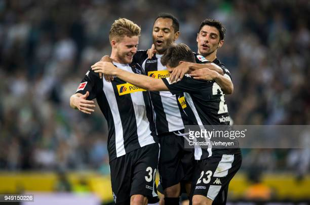Raffael Jonas Hofmann Nico Elvedi and Lars Stindl of Borussia Moenchengladbach celebrate the second goal during the Bundesliga match between Borussia...