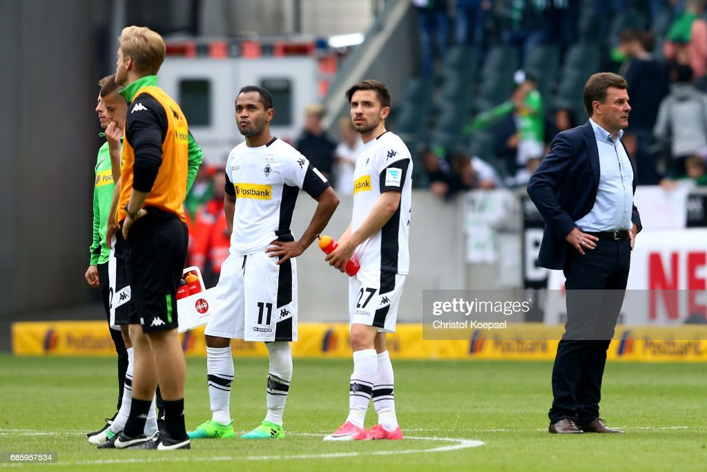 Raffael, Julian Korb and head coach Dieter Hecking of Moenchengladbach look dejected after the Bundesliga match between Borussia Moenchengladbach and SV Darmstadt 98 at Borussia-Park on May 20, 2017 in Moenchengladbach, Germany. The match between Moenchengladbach and Darmstadt ended 2-2.