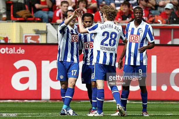 Raffael of Berlin celebrates his team's first goal with team mates Theofanis Gekas, Fabian Lustenberger and Adrian Ramos during the Bundesliga match...