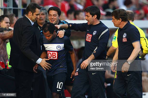 Raffael of Berlin celebrates with manager Michael Preetz, assistant coaches Ante Covic and Rene Tretschok and head coach Otto Rehhagel during the...