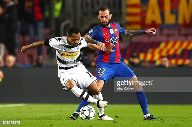 Raffael of Borussia Moenchengladbach and Aleix Vidal of Barcelona battle for possession during the UEFA Champions League Group C match between FC...