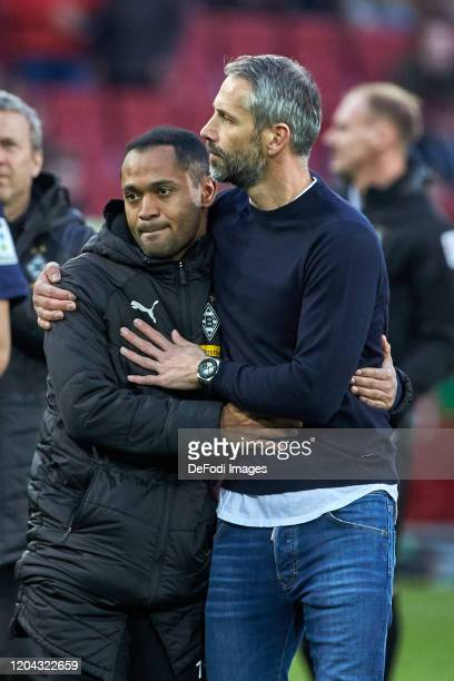 Raffael of Borussia Moenchengladbach and head coach Marco Rose of Borussia Moenchengladbach look on during the Bundesliga match between FC Augsburg...