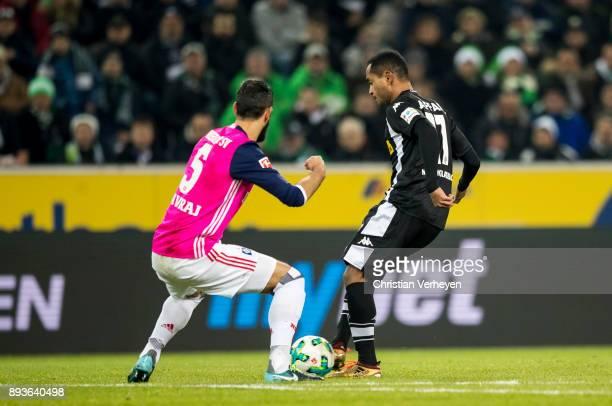 Raffael of Borussia Moenchengladbach and Mergim Mavraj of Hamburger SV battle for the ball during the Bundesliga match between Borussia...