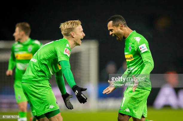 Raffael of Borussia Moenchengladbach celebrate with team mate Oscar Wendt after he scores his teams third goal during the Bundesliga match between...