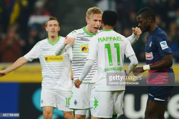 Raffael of Borussia Moenchengladbach celebrates first goal with teammate Oscar Wendt during the Bundesliga match between Borussia Moenchengladbach...
