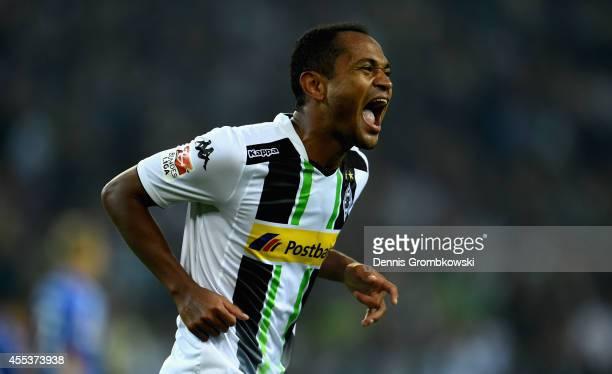 Raffael of Borussia Moenchengladbach celebrates scoring the fourth goal during the Bundesliga match between Borussia Moenchengladbach and FC Schalke...