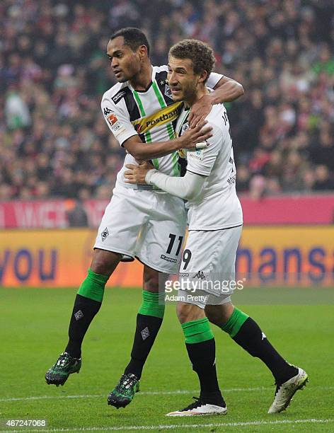 Raffael of Borussia Moenchengladbach celebrates with Fabian Johnson after scoring the first goal during the Bundesliga match between Bayern Muenchen...