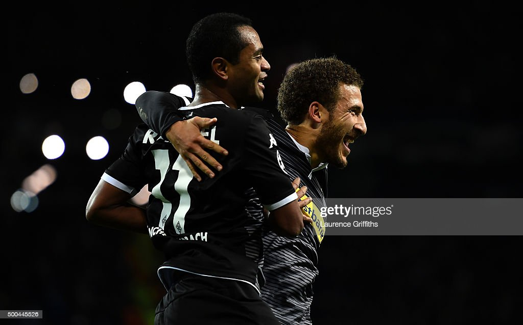 Raffael of Borussia Moenchengladbach (L) celebrates with Fabian Johnson of Borussia Moenchengladbach after scoring his side's second goal during the UEFA Champions League Group D match between Manchester City and Borussia Monchengladbach at Etihad Stadium on December 8, 2015 in Manchester, United Kingdom.