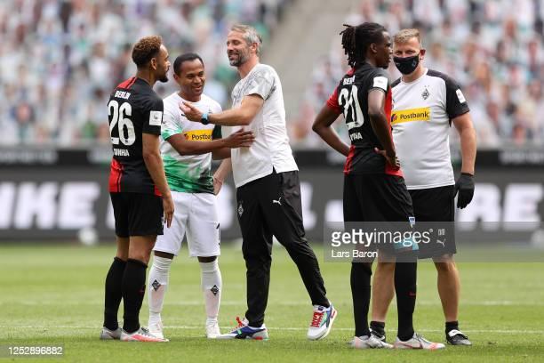 Raffael of Borussia Moenchengladbach celebrates with Marco Rose Head Coach of Borussia Moenchengladbach following their victory in the Bundesliga...