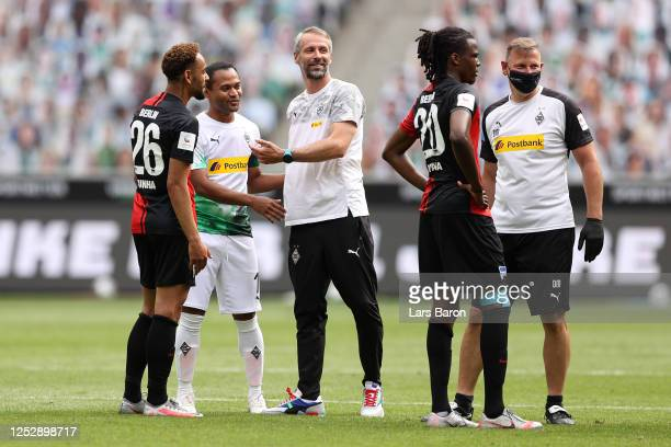 Raffael of Borussia Moenchengladbach celebrates with Marco Rose, Head Coach of Borussia Moenchengladbach following their victory in the Bundesliga...