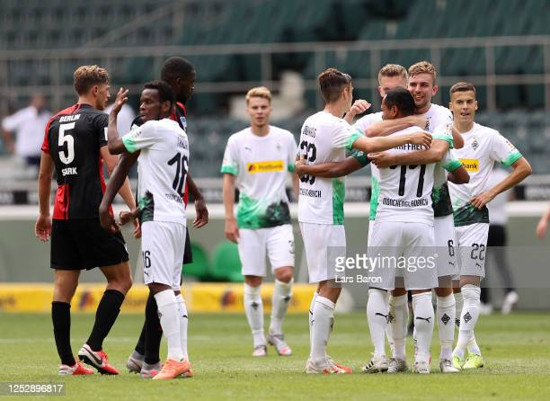 Raffael of Borussia Moenchengladbach embraces hos teammates following their victory in the Bundesliga match between Borussia Moenchengladbach and...