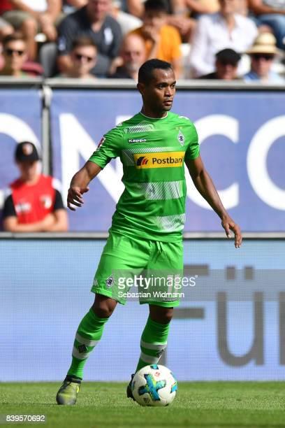 Raffael of Borussia Moenchengladbach plays the ball during the Bundesliga match between FC Augsburg and Borussia Moenchengladbach at WWKArena on...