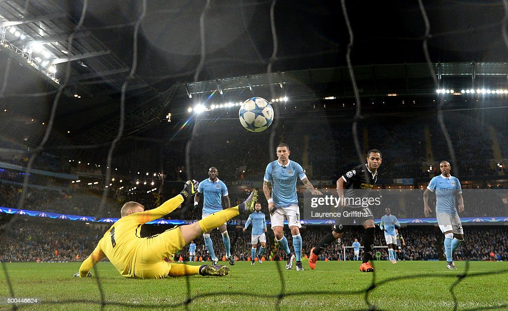 Raffael of Borussia Moenchengladbach scores his side's second goal past Joe Hart of Manchester City during the UEFA Champions League Group D match between Manchester City and Borussia Monchengladbach at Etihad Stadium on December 8, 2015 in Manchester, United Kingdom.