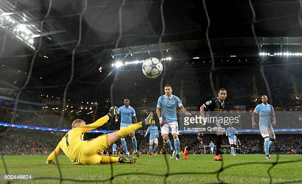 Raffael of Borussia Moenchengladbach scores his side's second goal past Joe Hart of Manchester City during the UEFA Champions League Group D match...