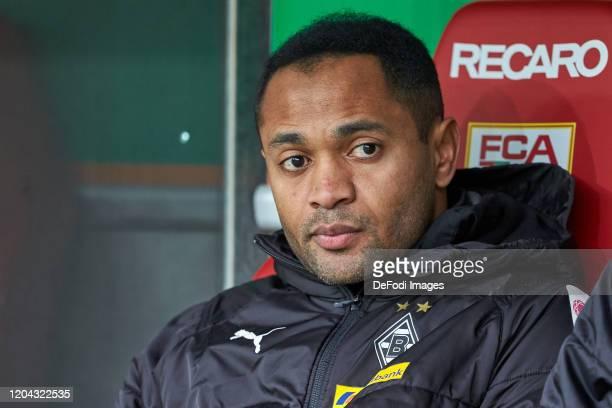 Raffael of Borussia Moenchengladbach sits on the bench during the Bundesliga match between FC Augsburg and Borussia Moenchengladbach at WWKArena on...