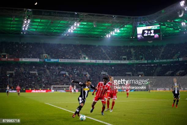 Raffael of Borussia Monchengladbach battles for the ball with Kwasi Okyere Wriedt of Bayern Munich during the Bundesliga match between Borussia...