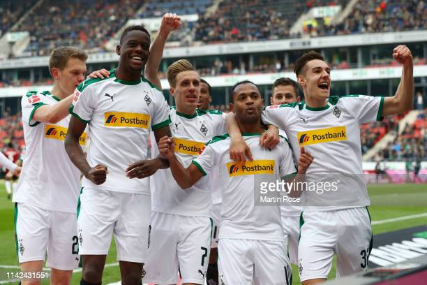 Raffael of Borussia Monchengladbach celebrates after scoring his team's first goal with his team mates during the Bundesliga match between Hannover...