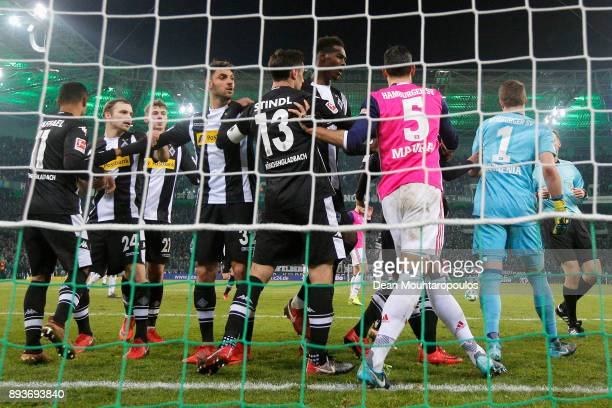 Raffael of Borussia Monchengladbach scores his teams third goal of the game with team mates then speaks to Goalkeeper Christian Mathenia and Mergim...