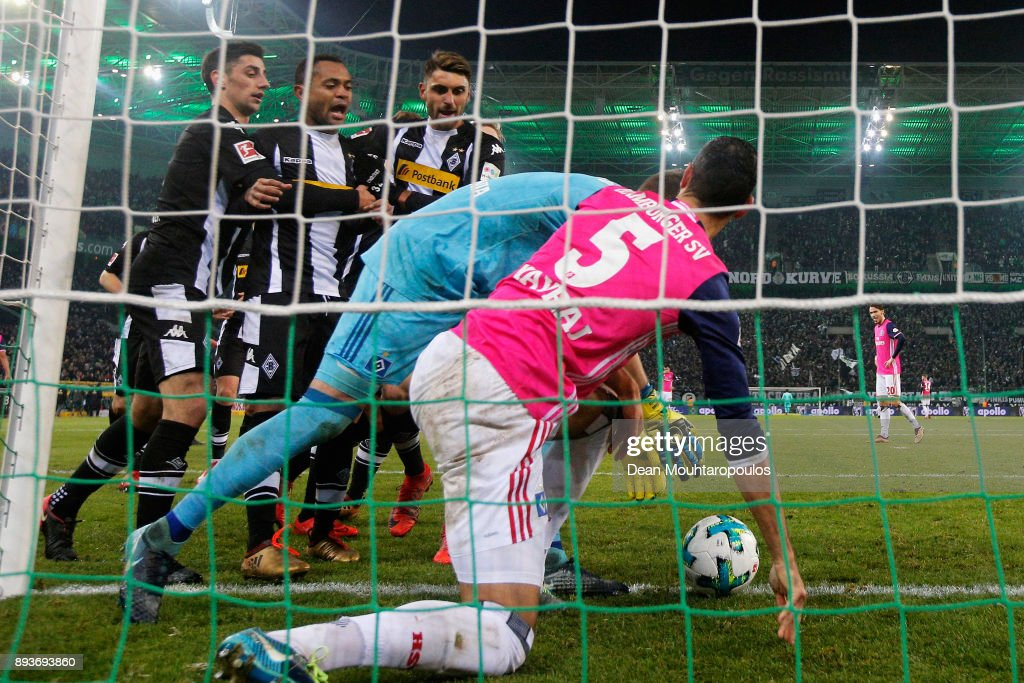 Raffael #11 of Borussia Monchengladbach scores his teams third goal of the game with team mates then speaks to Goalkeeper, Christian Mathenia and Mergim Mavraj of Hamburg during the Bundesliga match between Borussia Moenchengladbach and Hamburger SV at Borussia-Park on December 15, 2017 in Moenchengladbach, Germany.