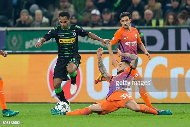 Raffael of Gladbach and Nicolas Otamendi of Manchester City battle for the ball during the UEFA Champions League match between VfL Borussia...