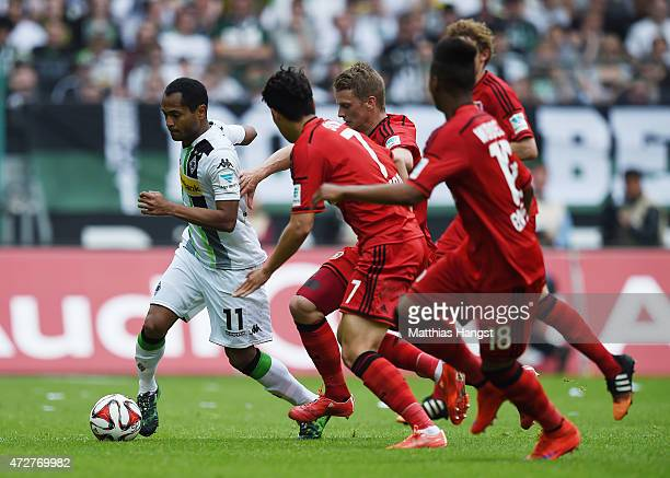 Raffael of Gladbach controls the ball against HeungMin Son Lars Bender Wendell and Stefan Kiessling of Leverkusen during the Bundesliga match between...