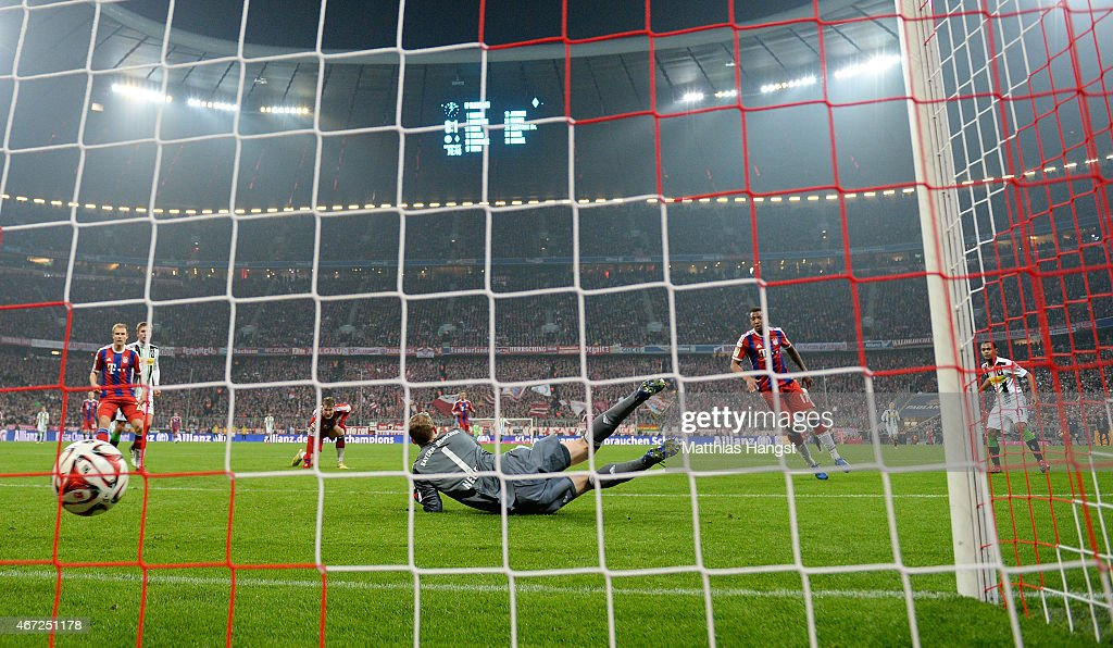 Raffael of Gladbach scores his team's second goal past goalkeeper Manuel Neuer of Muenchen during the Bundesliga match between FC Bayern Muenchen and Borussia Moenchengladbach at Allianz Arena on March 22, 2015 in Munich, Germany.