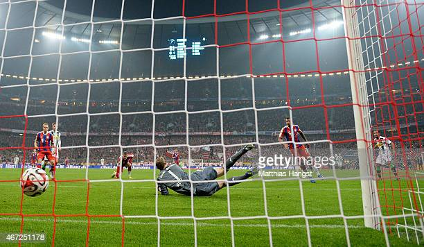 Raffael of Gladbach scores his team's second goal past goalkeeper Manuel Neuer of Muenchen during the Bundesliga match between FC Bayern Muenchen and...
