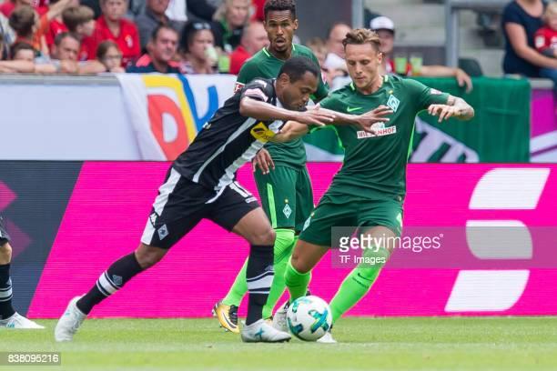 Raffael of Gladbach und Robert Bauer of Bremen battle for the ball during the Telekom Cup 2017 match between Borussia Moenchengladbach and Werder...