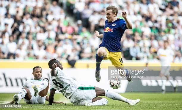 Raffael of Moenchengladbach and Denis Zakaria of Moenchengladbach challenge Emil Forsberg of Leipzig during the Bundesliga match between Borussia...