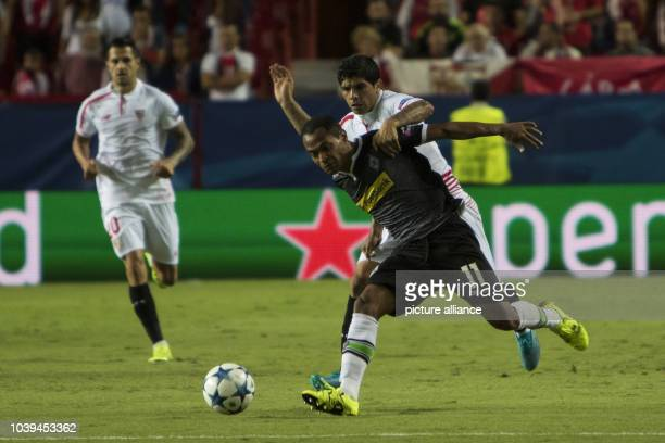 Raffael of Moenchengladbach and Ever Banega of Sevilla fight for the ball during the UEFA Champions League Group D soccer match between Sevilla FC...