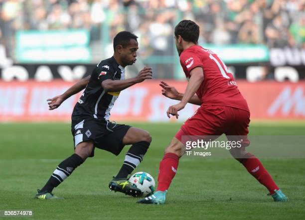 Raffael of Moenchengladbach and Jonas Hector of Koeln battle for the ball during the Bundesliga match between Borussia Moenchengladbach and 1 FC...