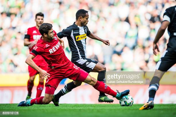 Raffael of Moenchengladbach and Jonas Hector of Koeln fight for the ball during the Bundesliga match between Borussia Moenchengladbach and 1 FC Koeln...