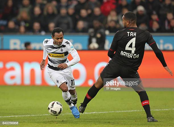Raffael of Moenchengladbach and Jonathan Tah of Leverkusen battle for the ball during the Bundesliga match between Bayer 04 Leverkusen and Borussia...