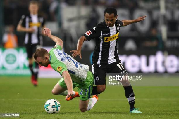 Raffael of Moenchengladbach and Maximilian Arnold of VfL Wolfsburg battle for the ball during the Bundesliga match between Borussia Moenchengladbach...