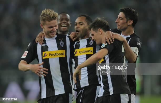 Raffael of Moenchengladbach celebrates after scoring his team`s second goal with Nico Elvedi of Moenchengladbach Jonas Hofmann of Moenchengladbach...