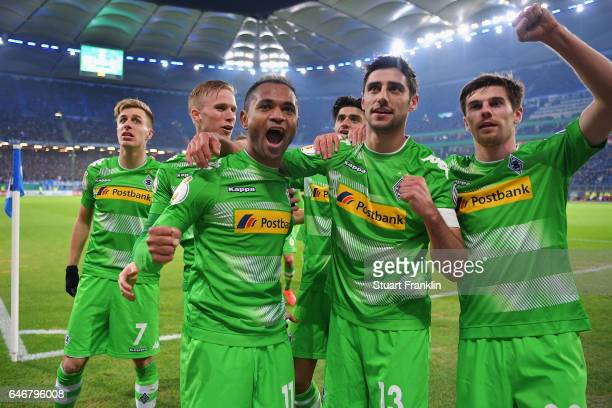 Raffael of Moenchengladbach celebrates his team's second goal with team mates during the DFB Cup quarter final between Hamburger SV and Borussia...