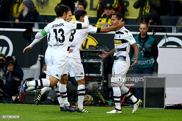 Raffael of Moenchengladbach celebrates the first goal with his team mates during the Bundesliga match between Borussia Dortmund and Borussia...
