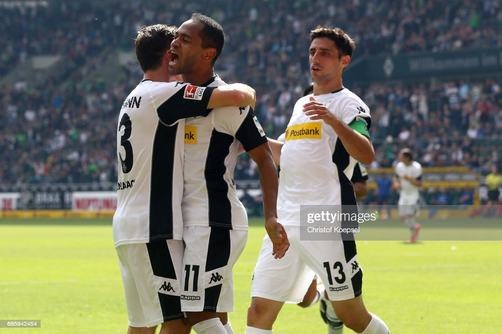 Raffael of Moenchengladbach celebrates the second goal with Andreas Christensen (L) during the Bundesliga match between Borussia Moenchengladbach and SV Darmstadt 98 at Borussia-Park on May 20, 2017 in Moenchengladbach, Germany.