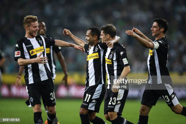 Raffael of Moenchengladbach celebrates with his team mates after scoring his teams second goal to make it 20 during the Bundesliga match between...